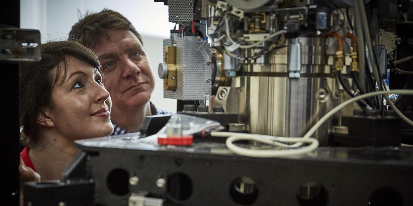 This image shows Professor Neil Ranson and Dr Rebecca Thompson looking at one of the University of Leeds' cryo-electron microscopes